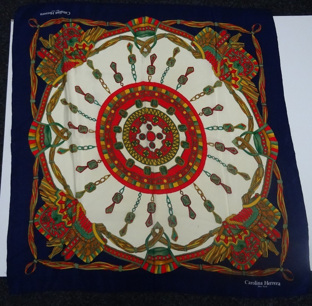 A collection of four designer silk scarves, comprising: a Jean Patou silk scarf designed with a... Image