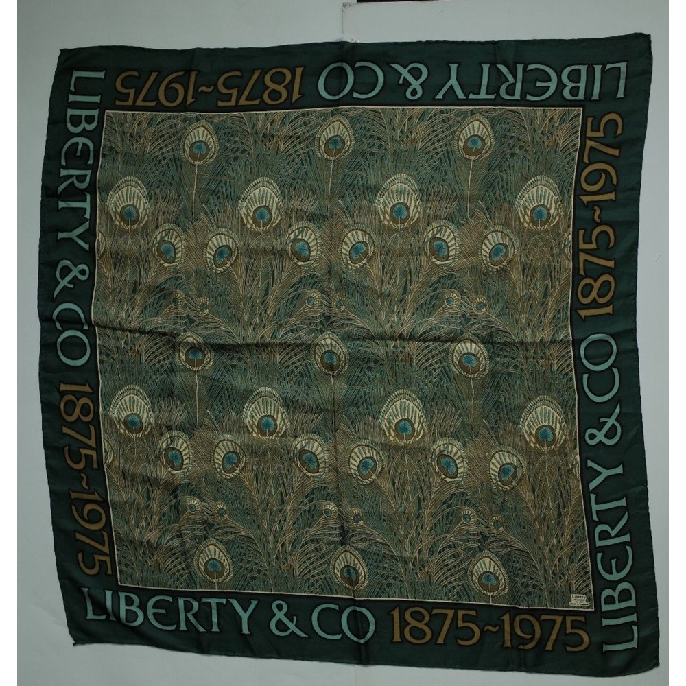 A Liberty of London 1875-1975 centenary edition printed silk scarf, the green field designed with... Image