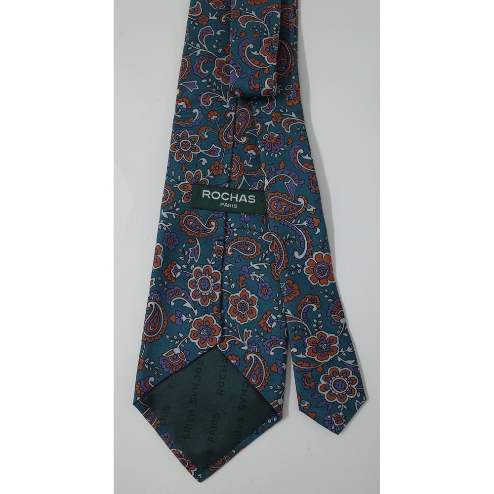 A Hermes of Paris pale yellow silk tie, printed all over in blues with cows beneath trees,... Image