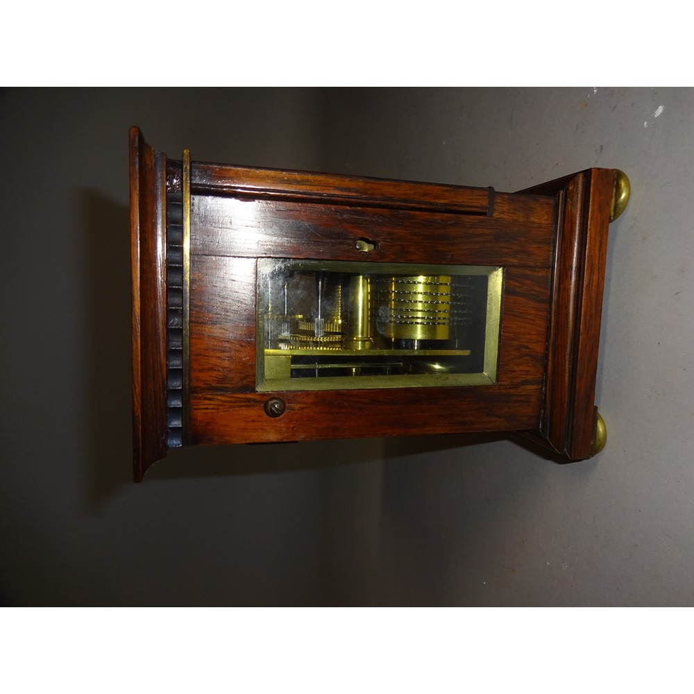 A William IV rosewood mantel timepieceThe top with inset flush carrying handle, 3in square... Image