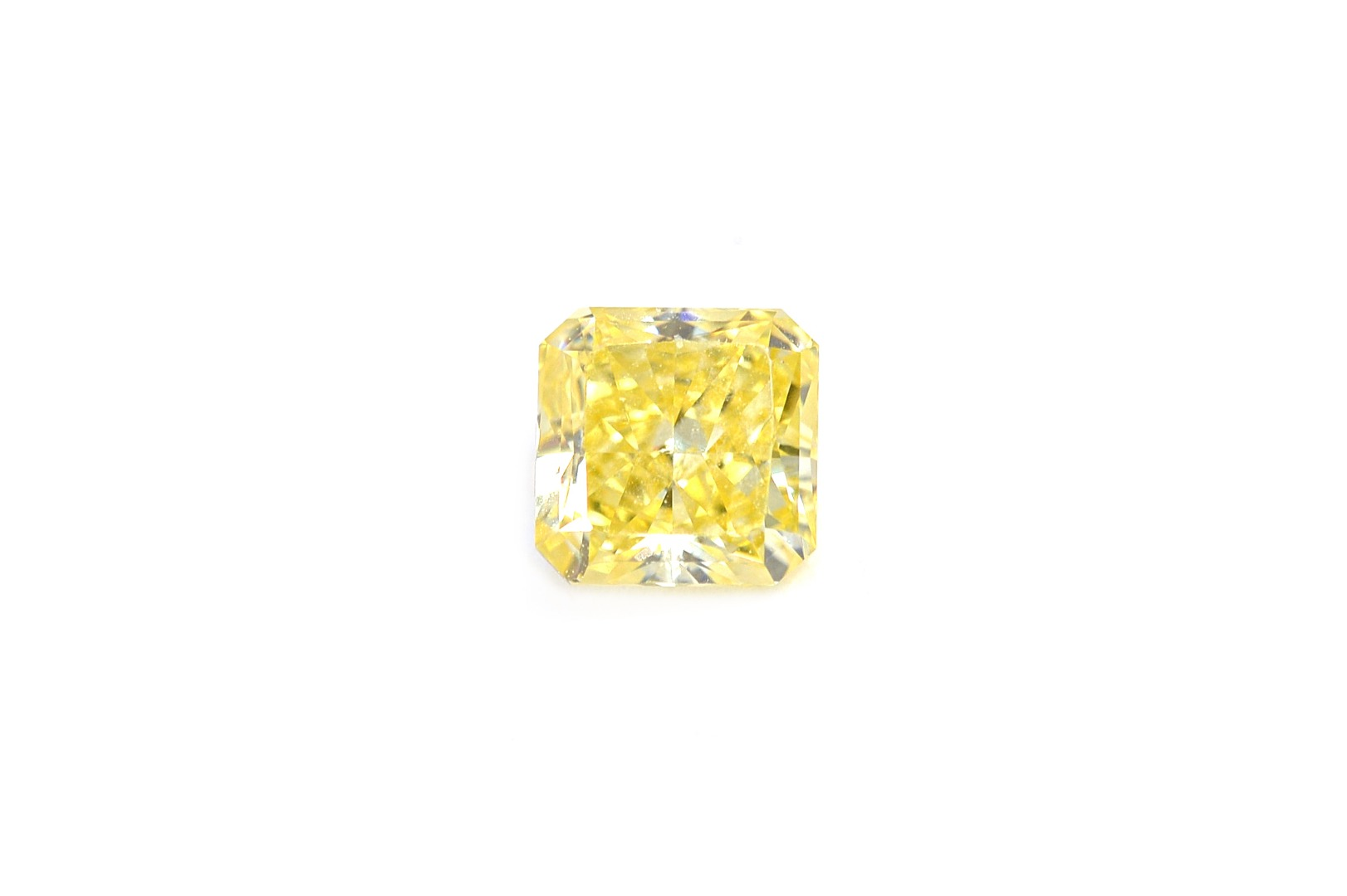 A radiant-cut fancy intense yellow loose... Image