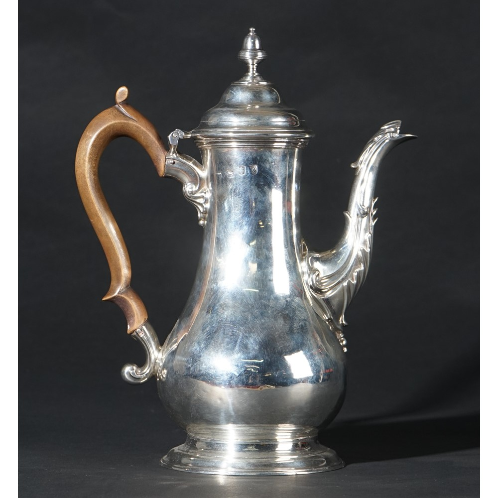 A George III silver coffee pot of baluster form, the hinged lid with an associated detachable... Image