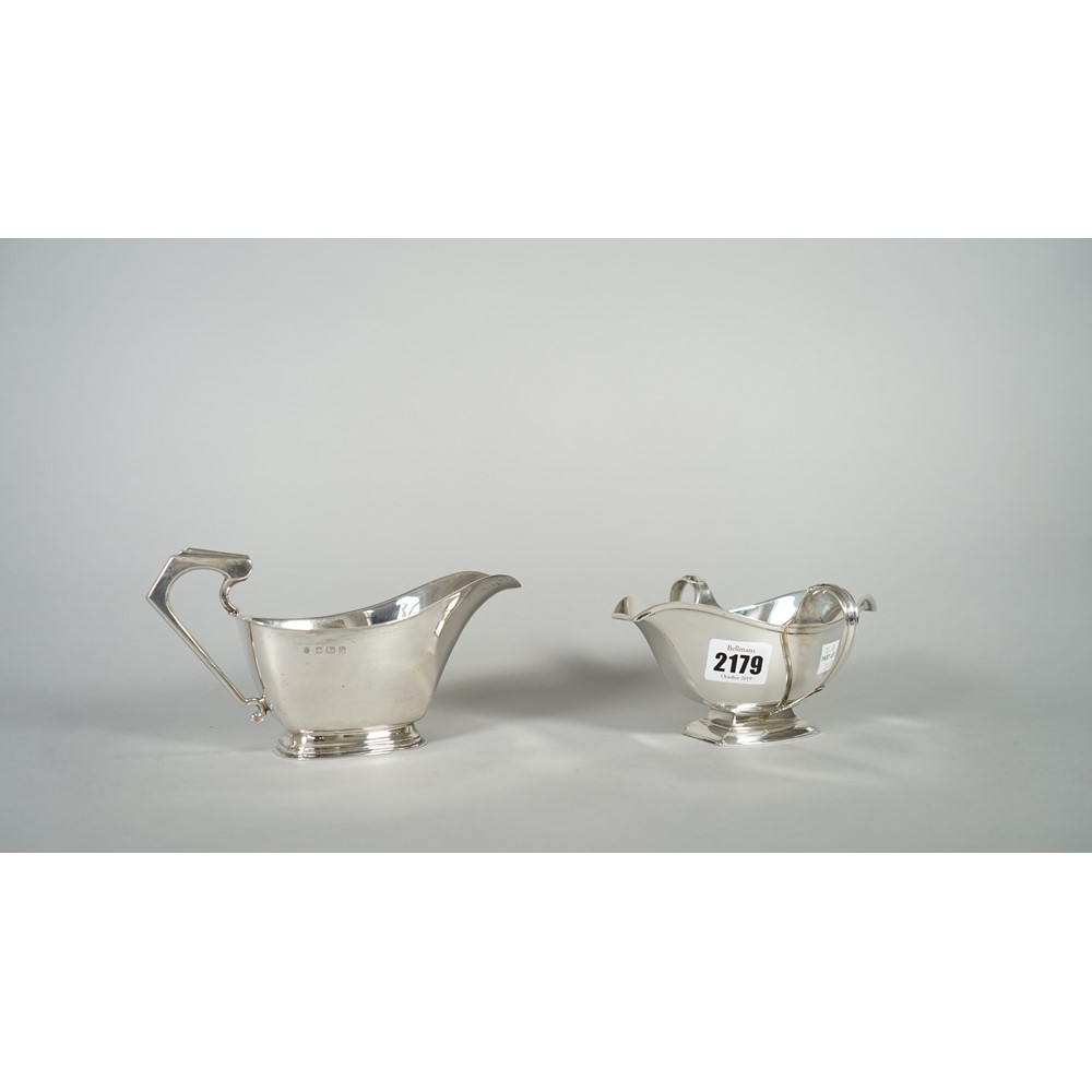 Silver, comprising; a twin handled double ended sauceboat, raised on a curved rectangular foot,... Image