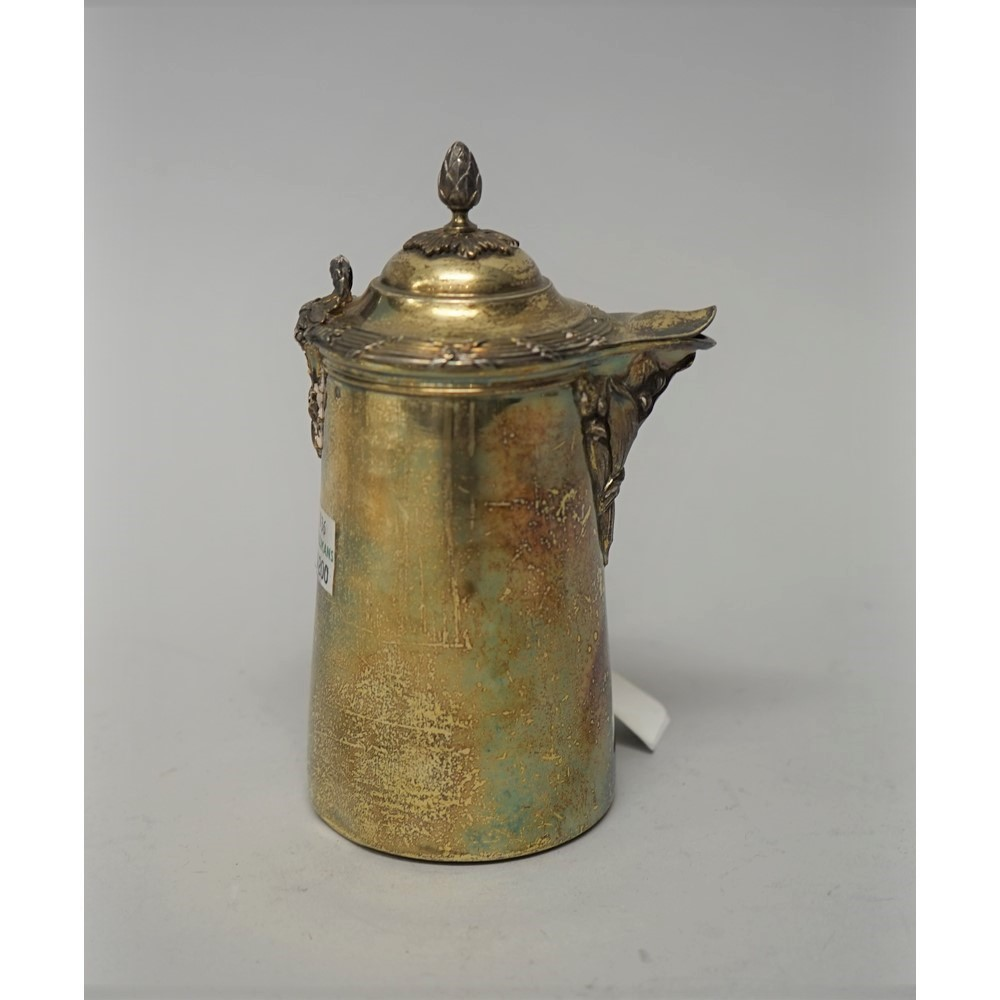 Boin-Taburet, Paris; a late 19th century parcel gilt silver chocolate pot in the Regence manner,... Image