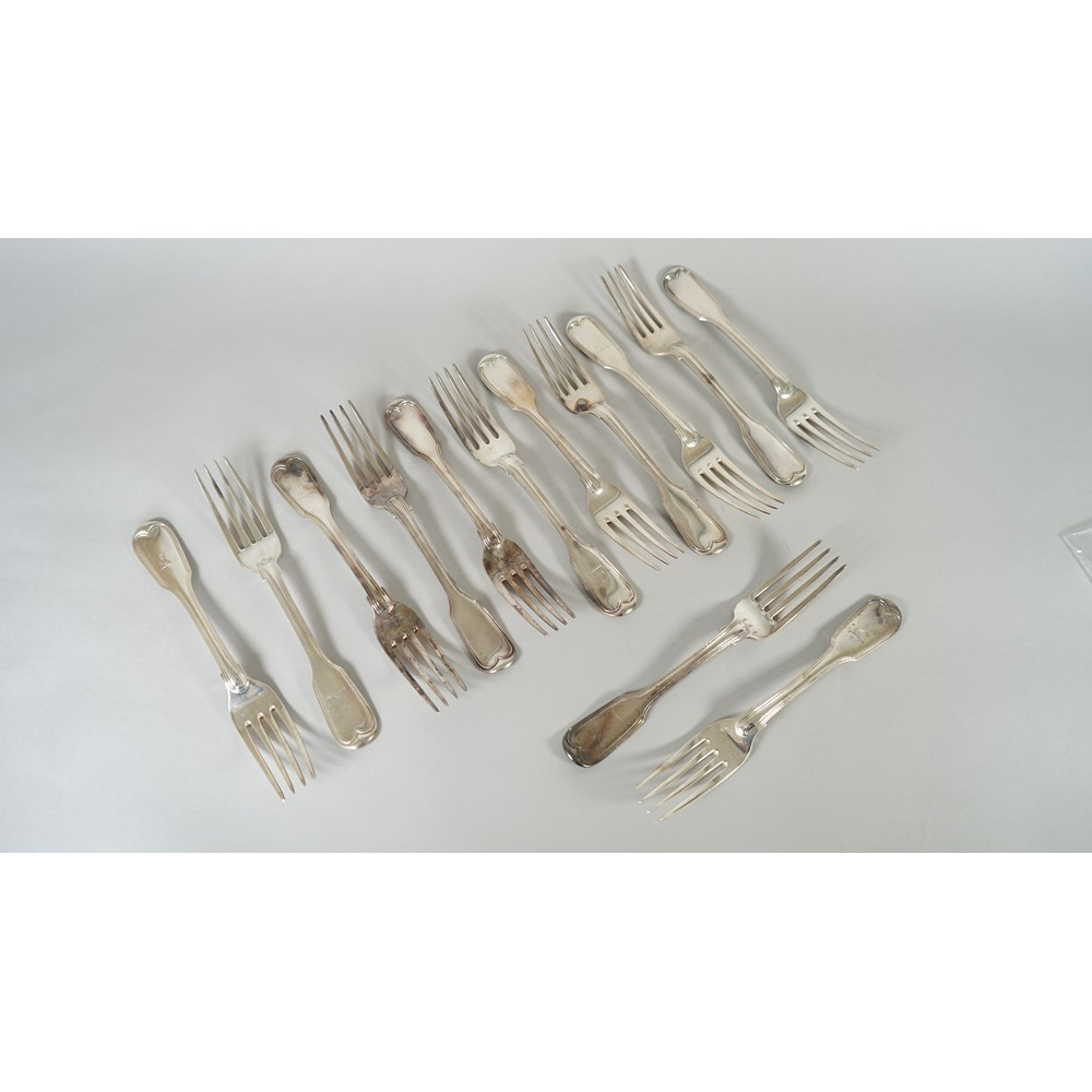 Thirteen silver double struck fiddle and thread pattern table forks, mixed dates, some crest... Image