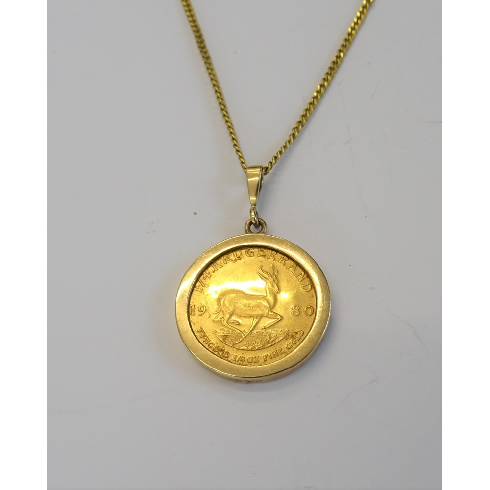 A South Africa one quarter krugerrand 1980, in a gold pendant mount with a gilt metal neckchain,... Image