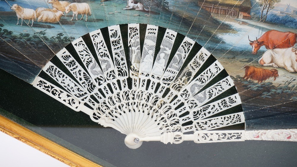A Continental painted paper fan, late 18th century, the leaf hand-painted depicting a farmyard... Image