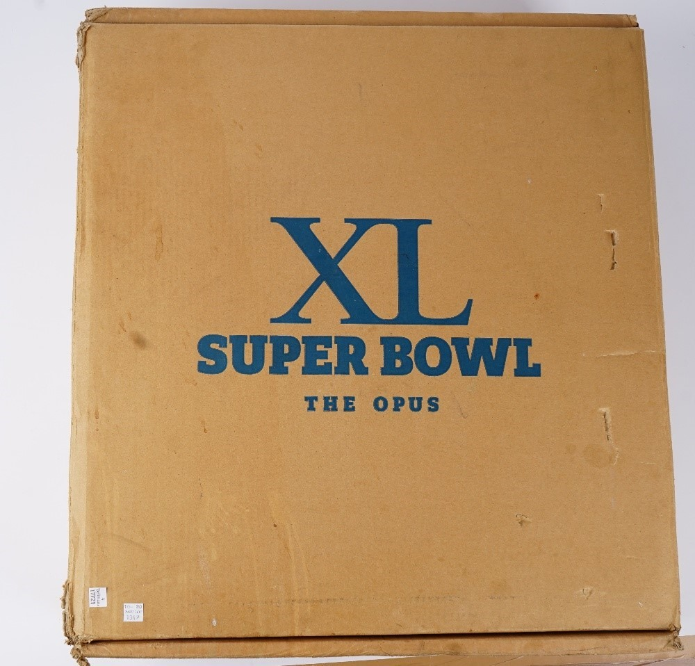 An Opus Super Bowl XL limited edition number 00456 book, with case, paperwork and white gloves. Image