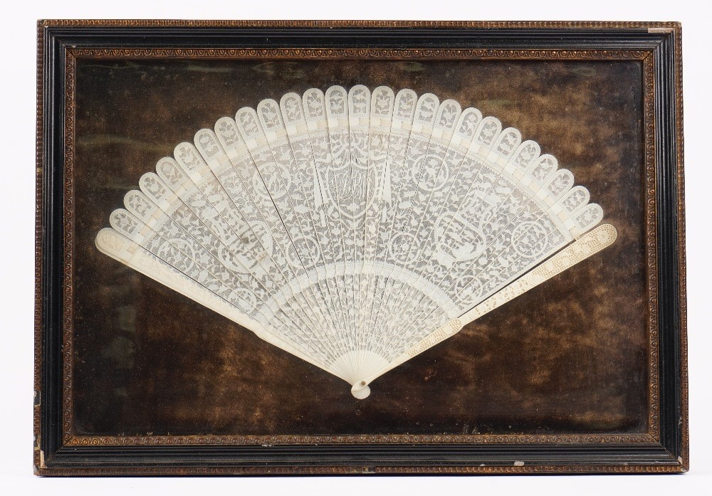 A Canton export ivory brise fan, late 18th century, the sticks carved with vases, flowerheads,... Image