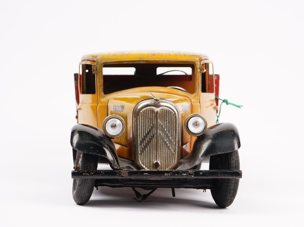 A tinplate model of a Citroen flatbed truck, probably French, Circa 1930, finished in red and... Image