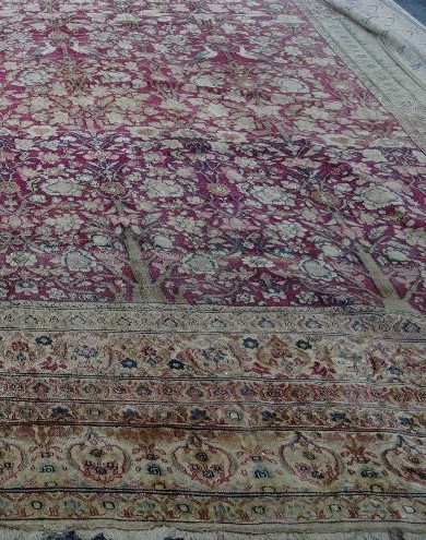 A silk Amritsar carpet, Indian, the crimson pink field with an all over design of abundantly... Image