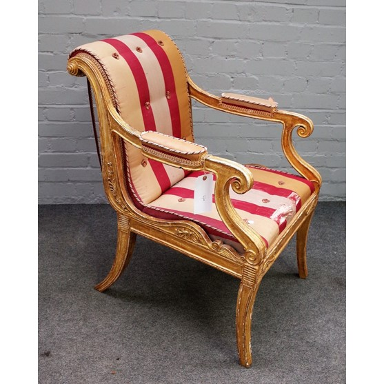 A Regency gilt framed open armchair, with semi-padded arms and straight front seat, on sabre... Image