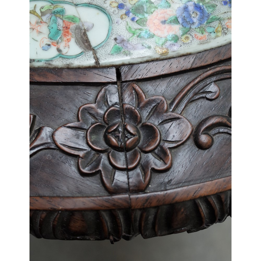 A 19th century Chinese export occasional table, the circular top inset with a ceramic famille... Image