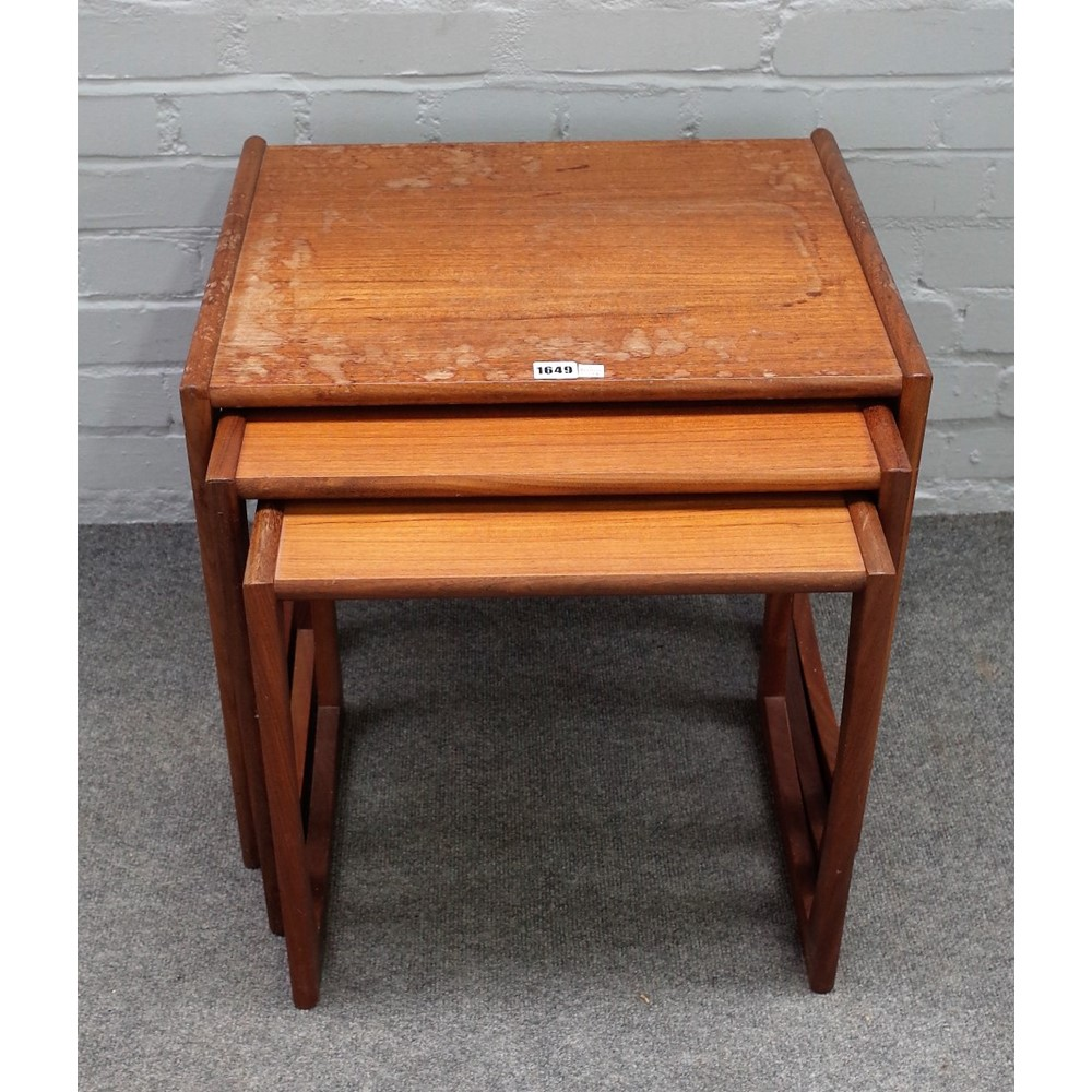 G PLAN;  a nest of three teak occasional tables, the larger 54cm wide x 49cm high. Image