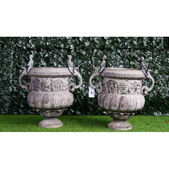 A pair of lead urns, in Louis XIV arabesque style, after a design by John Van Nost for William... Image