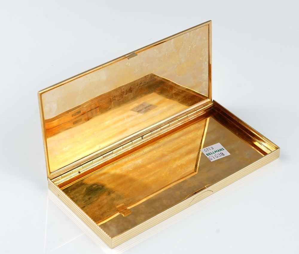 A Cartier gold rectangular cigarette case, the exterior with banded decoration, detailed CARTIER... Image