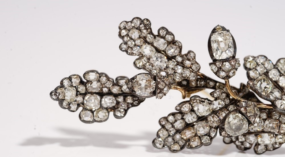 A diamond brooch, first half of the 19th century, designed as a spray of oak leaves with acorns,... Image