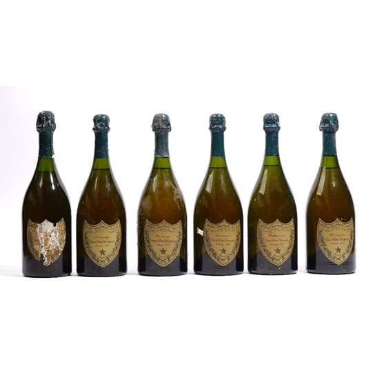 Six bottles of Dom Perignon vintage champagne, five 1966 and one having the label deteriorated. Image