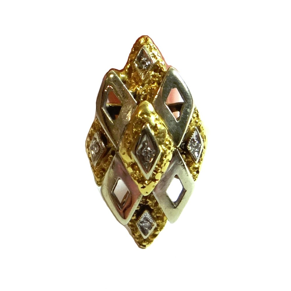A two colour gold and diamond set ring,... Image