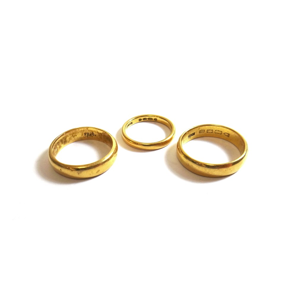 Two 22ct gold plain wedding rings and a... Image