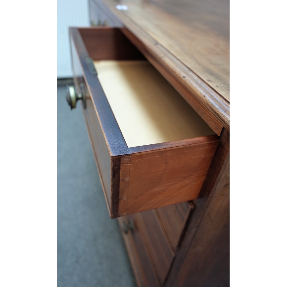 A late George III mahogany chest of two short and three long graduated drawers on bracket feet,... Image