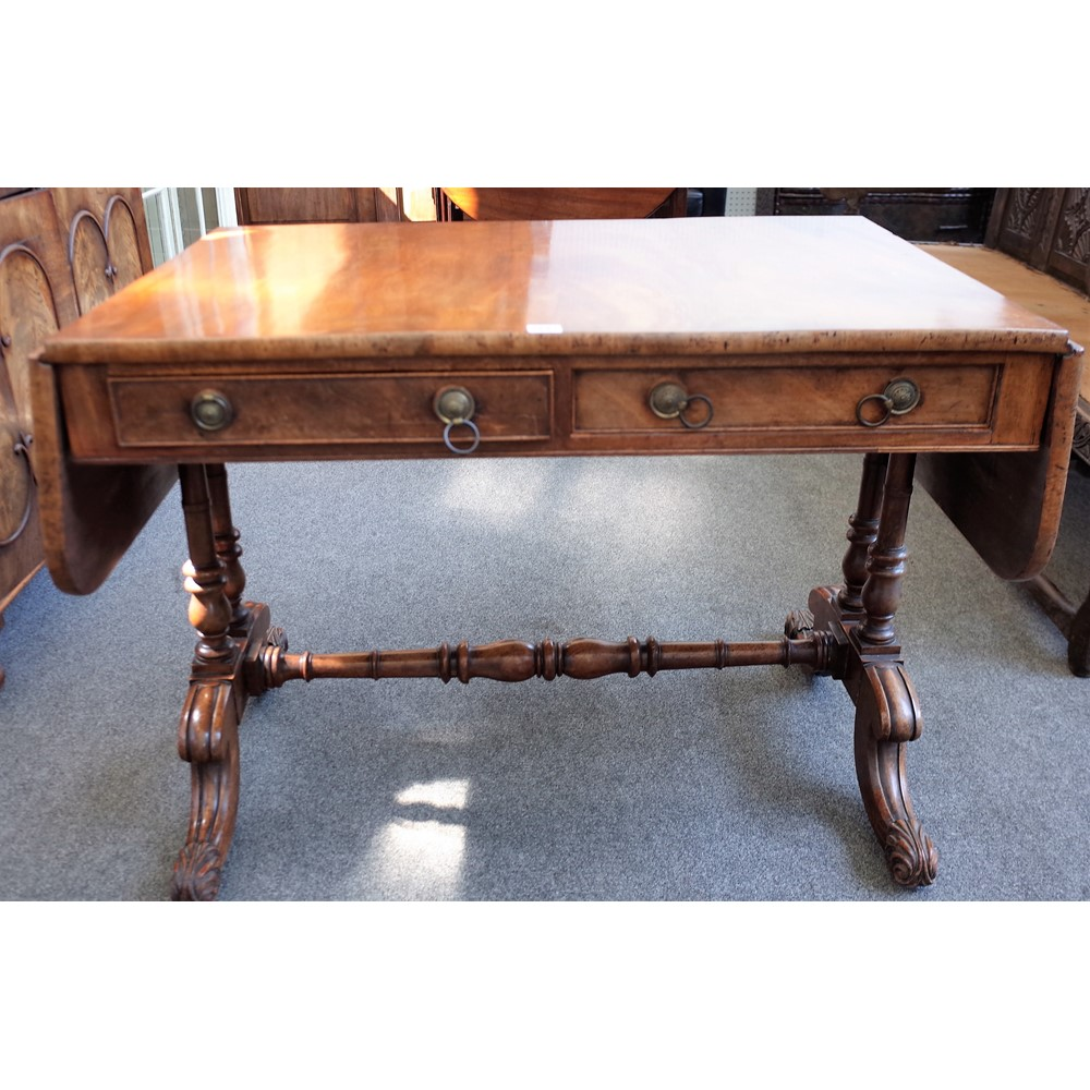 A George IV mahogany sofa table, with a pair of frieze drawers on four downswept supports, 104cm... Image