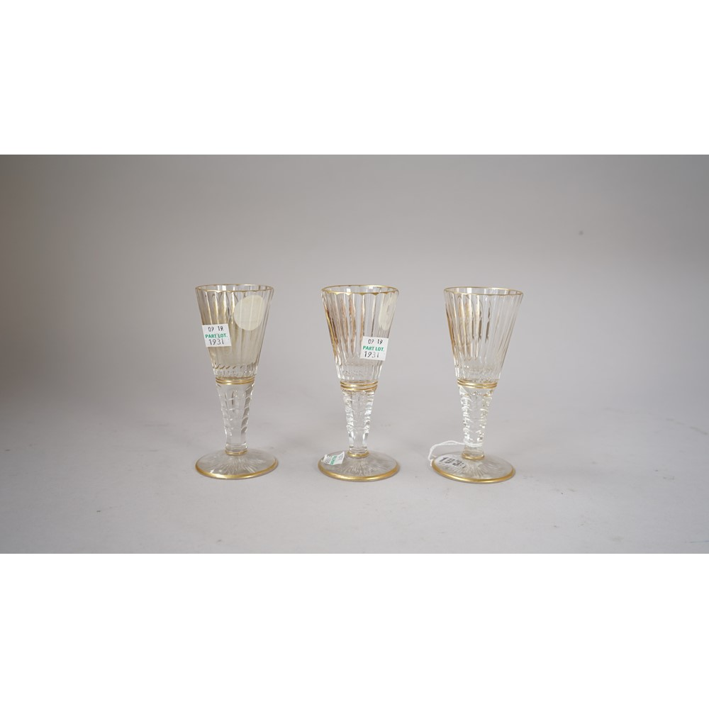 Three Silesian cut and gilt wine glass, early 20th century, the flared and fluted bowls gilt with... Image