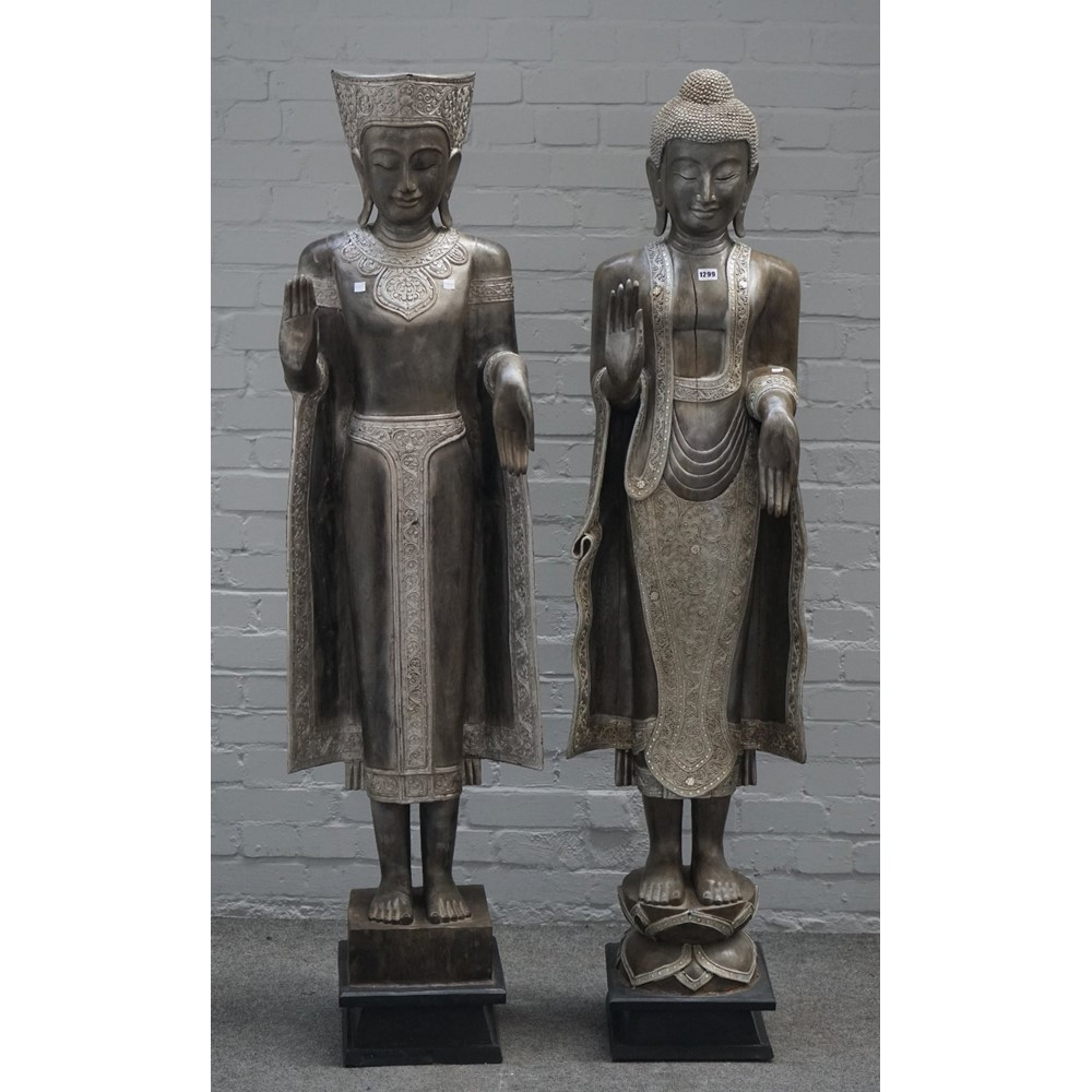 A modern pair of south east Asian hardwood Buddhas, on square ebonised plinths, approximately... Image