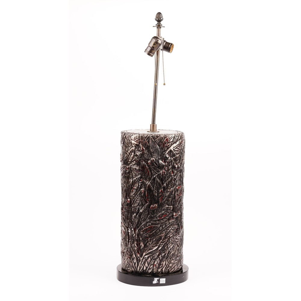 A silvered carved wooden lamp, 80cm high, with a shade. Image