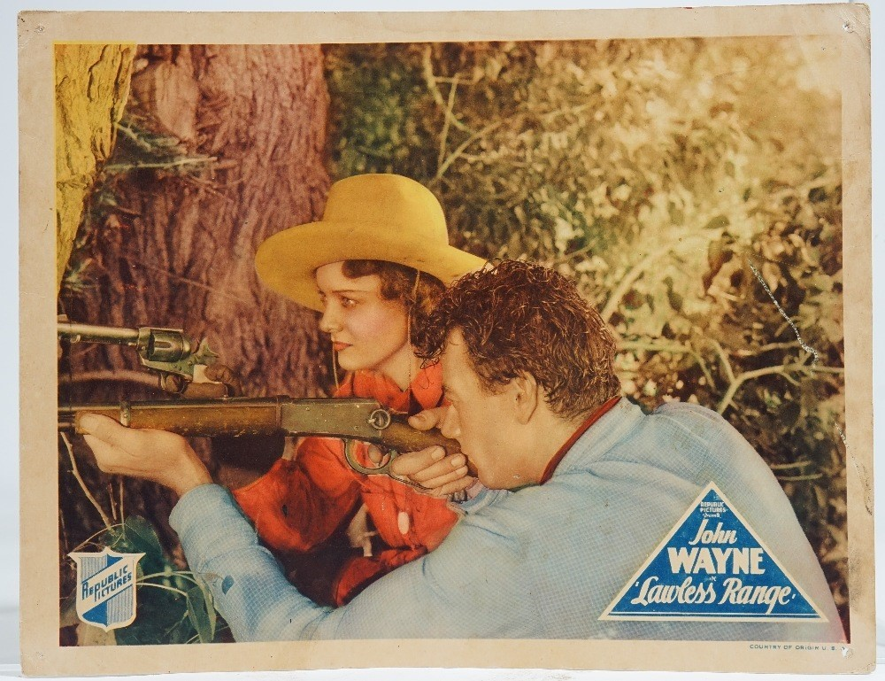 John Wayne 'Lawless Range, four lobby cards and a Seven Sinners lobby card, (5). Image