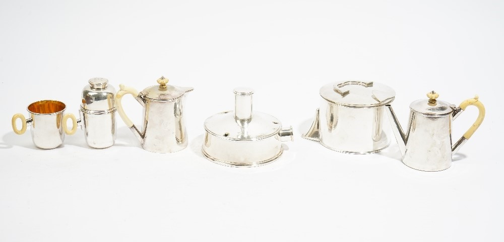 A Victorian leather cased travelling tea set, comprising; two silver spoons, London 1876 and a... Image