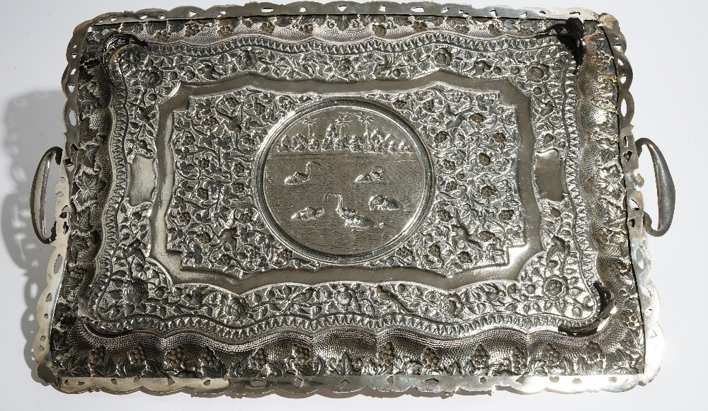 An Asian shaped rectangular twin handled tray, the central reserve decorated with elephants... Image