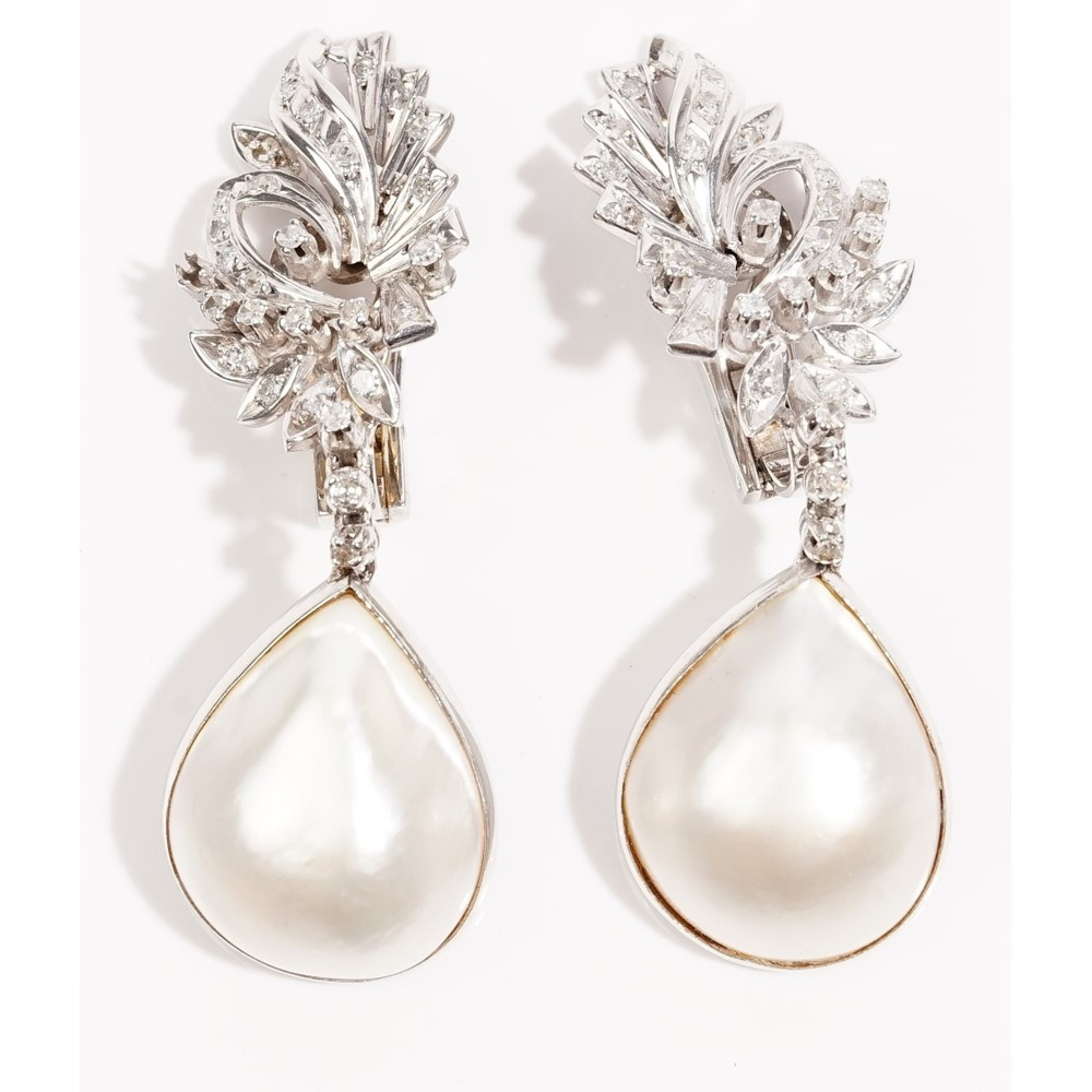 A pair of mabé cultured pearl and diamond-setpendent earringsThe floral spray earclips set... Image