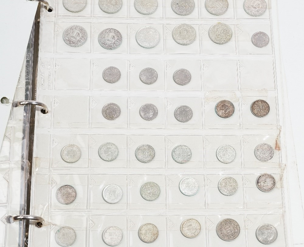 A collection of foreign and British coins, including: a Charles III Mexico City mint, 8 reales,... Image