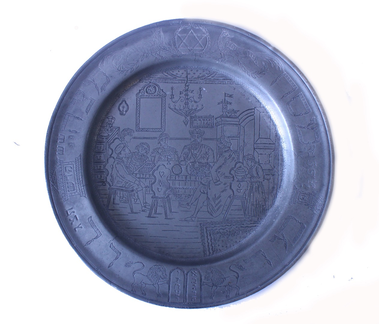 A pewter dish, the centre engraved with... Image