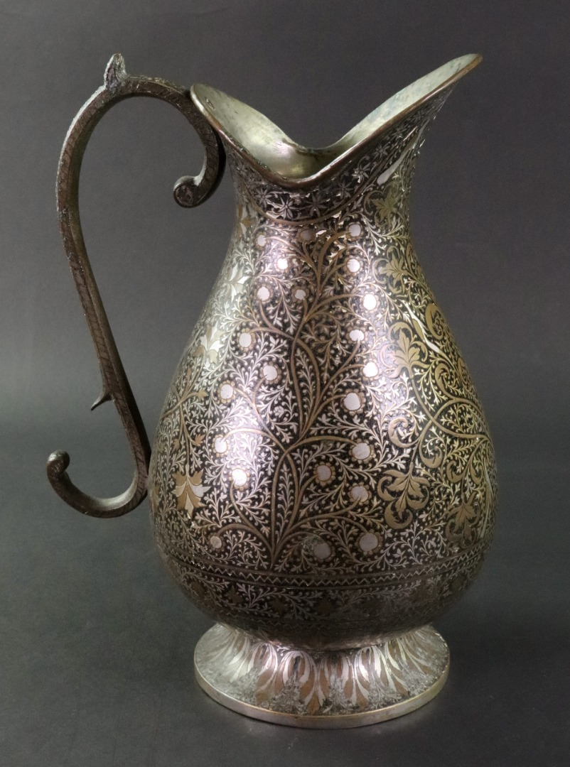A metalwork Indo Persian ewer, decorated... Image