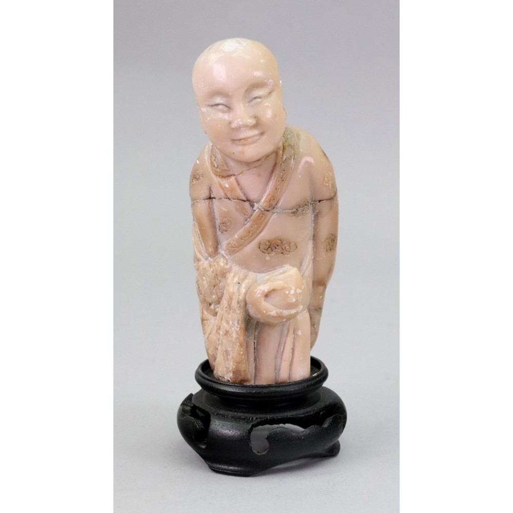 A Chinese green quartz figure of... Image