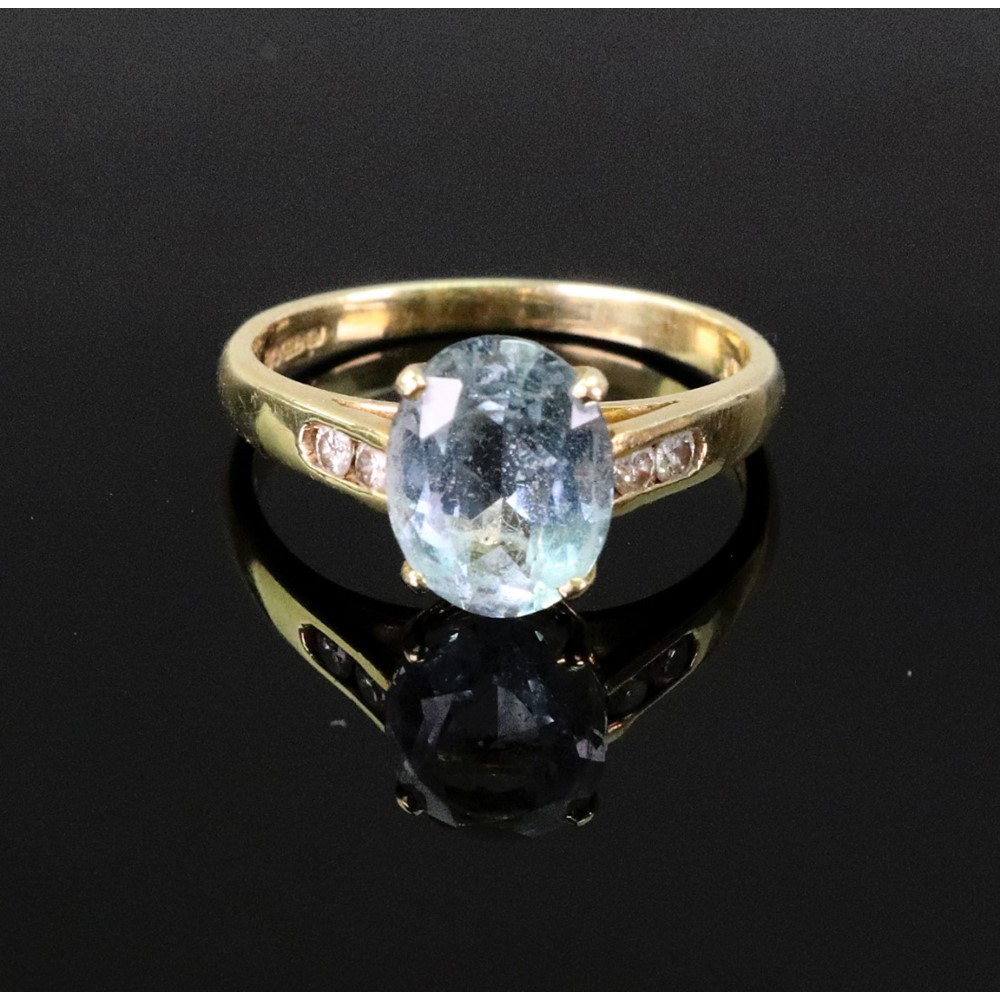 An 18ct gold and oval aquamarine... Image