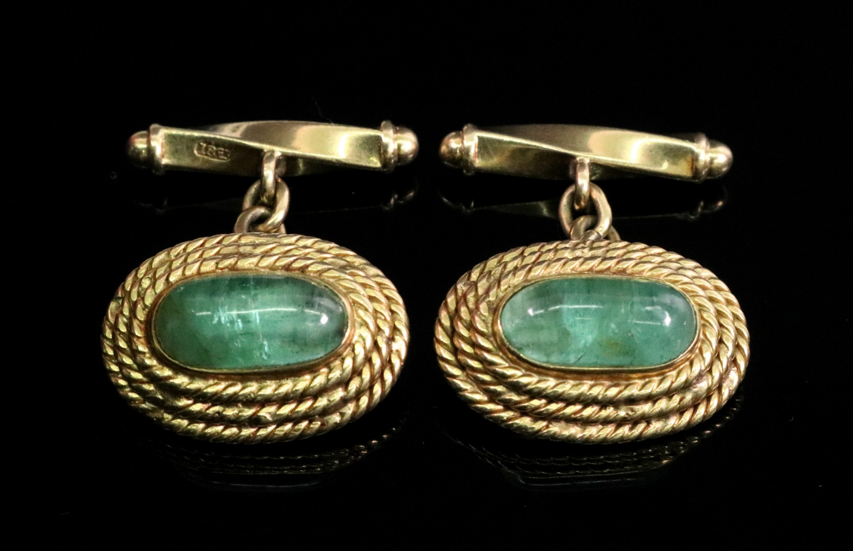 A pair of oval cuff links, circa 1960's,... Image