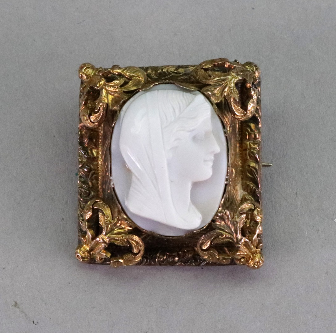 A white agate cameo brooch, carved as a... Image