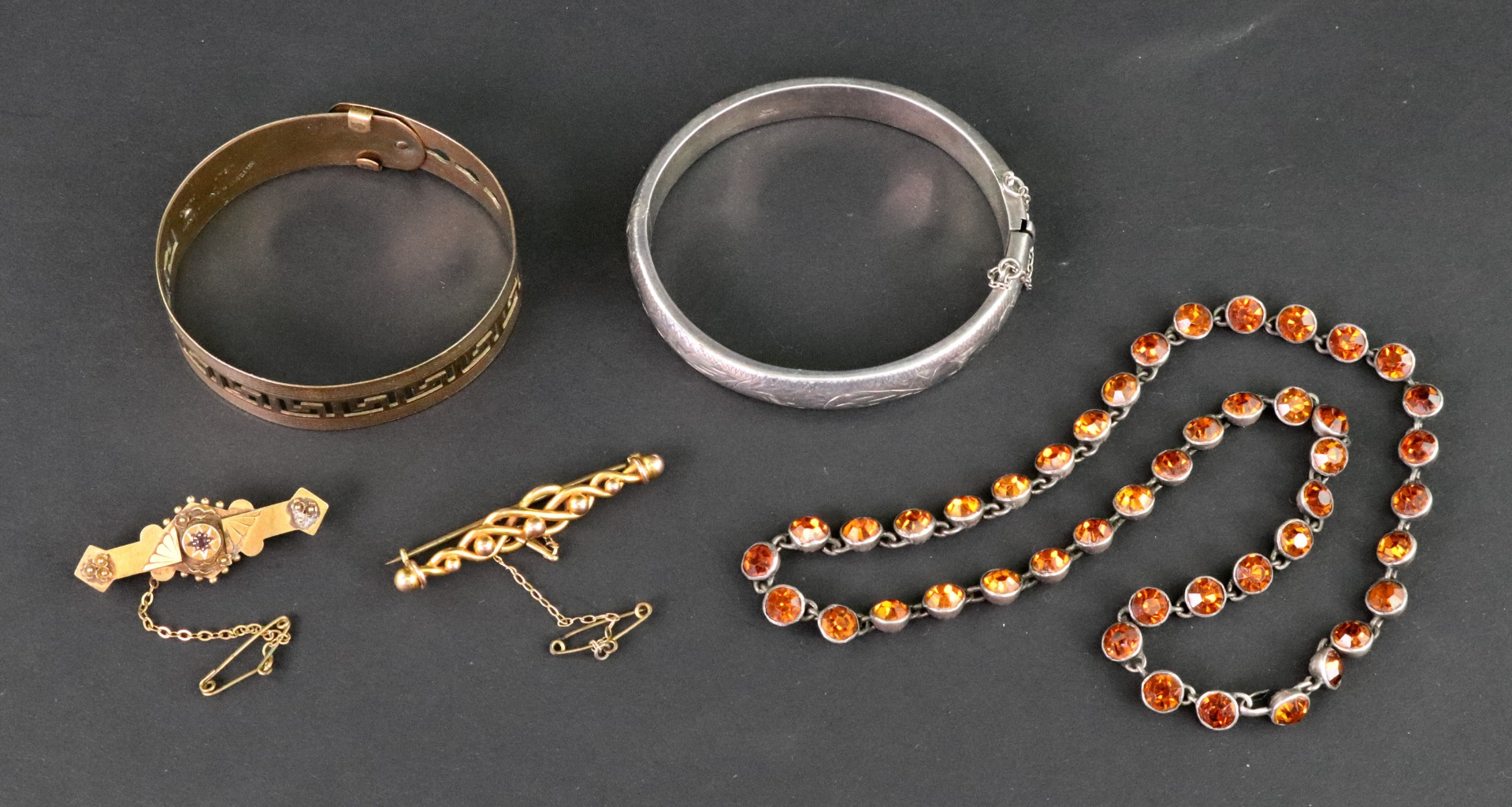 A collection of jewellery comprising; an... Image