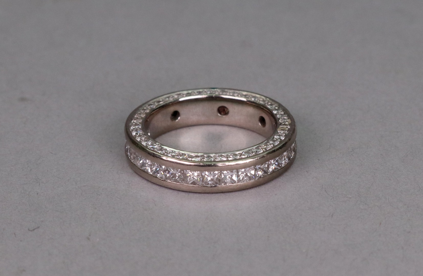 An 18ct white gold full eternity ring,... Image