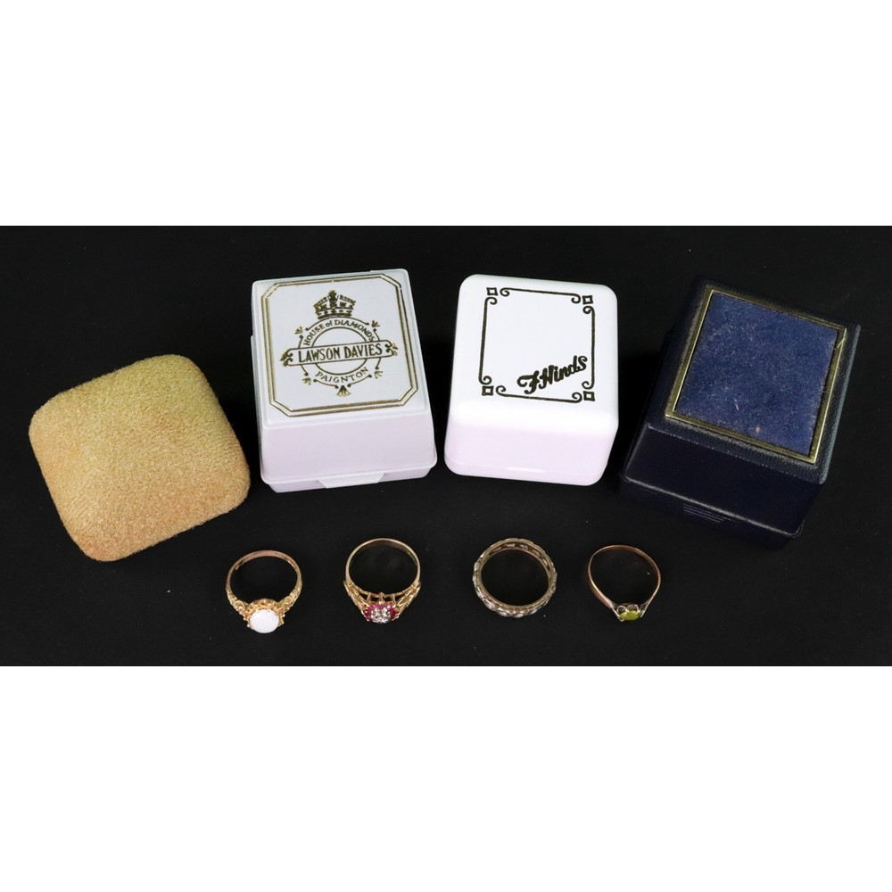 A group of four gold and gem set rings,... Image