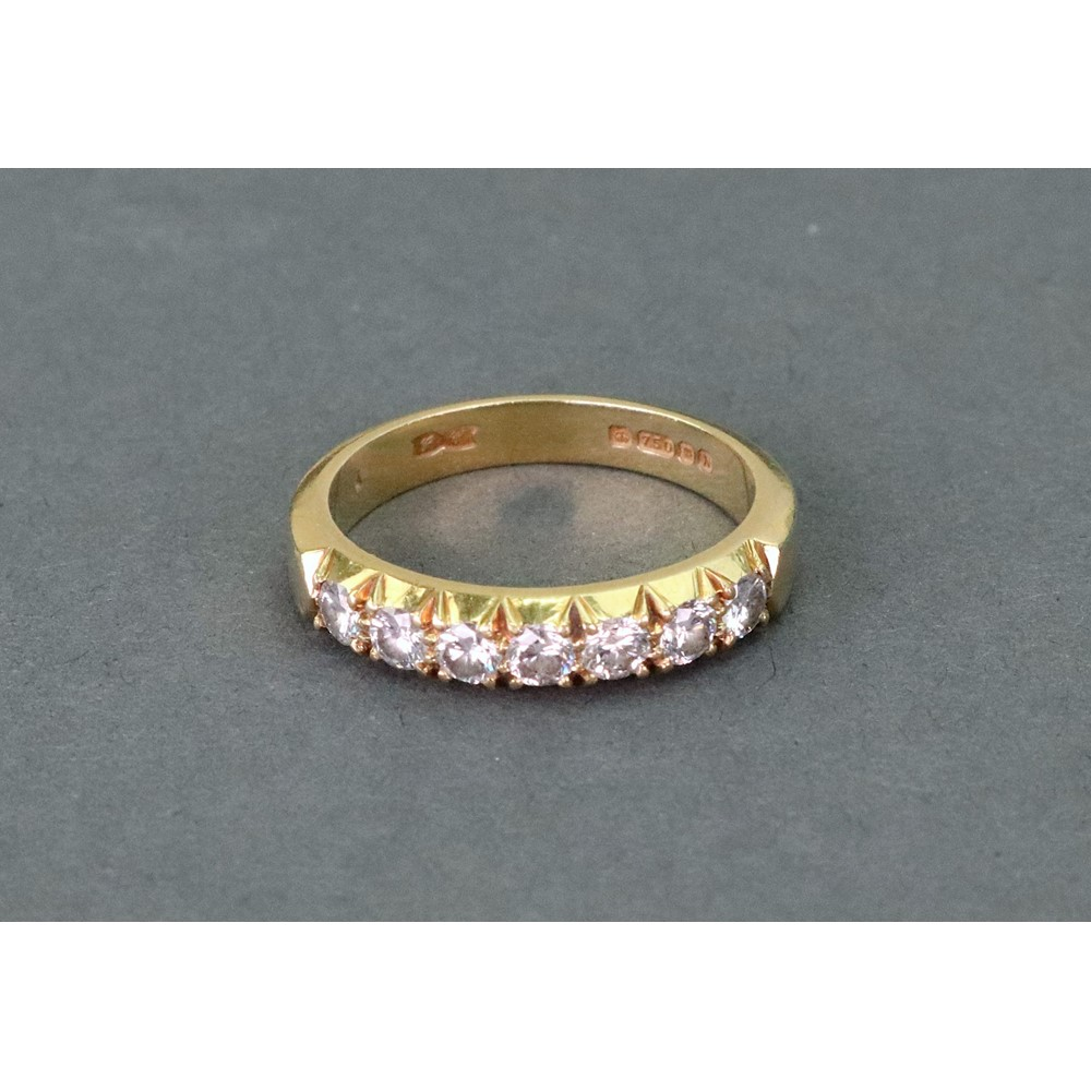 An 18ct gold and diamond seven stone... Image