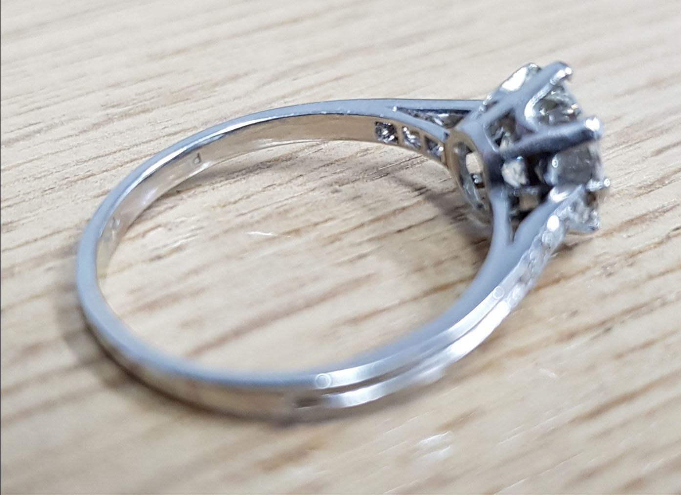 A platinum and diamond solitaire ring,... Image