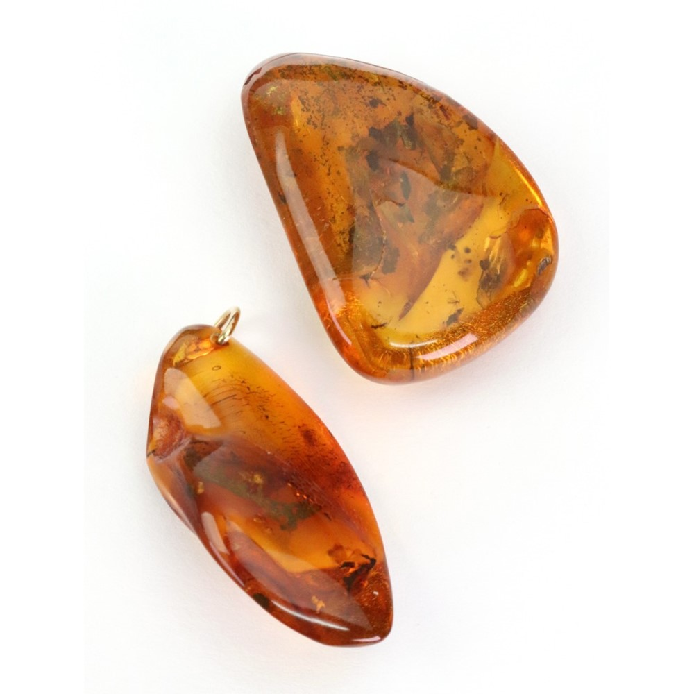 An amber pendant, the amber mounted with... Image