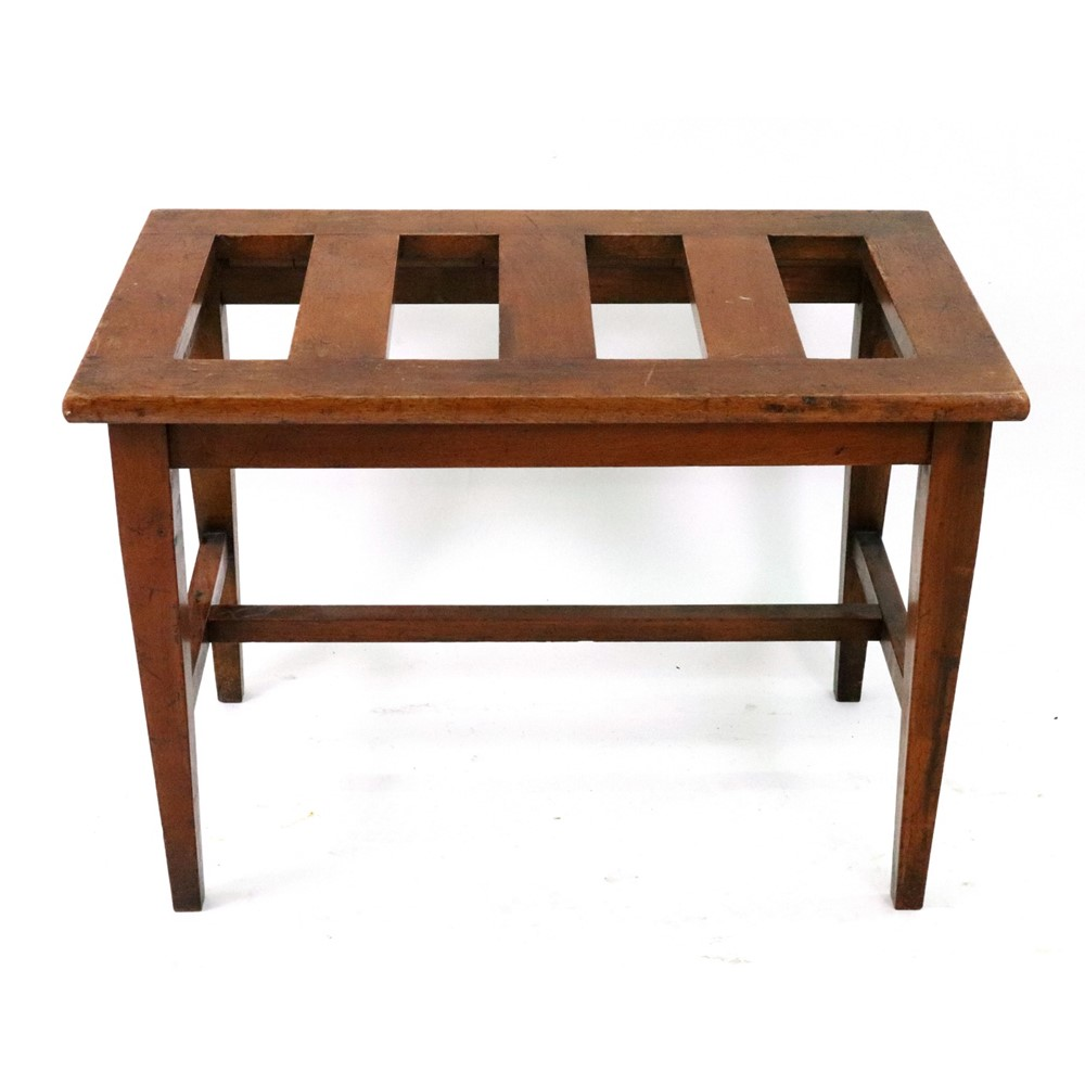 An Edwardian walnut luggage rack, with... Image