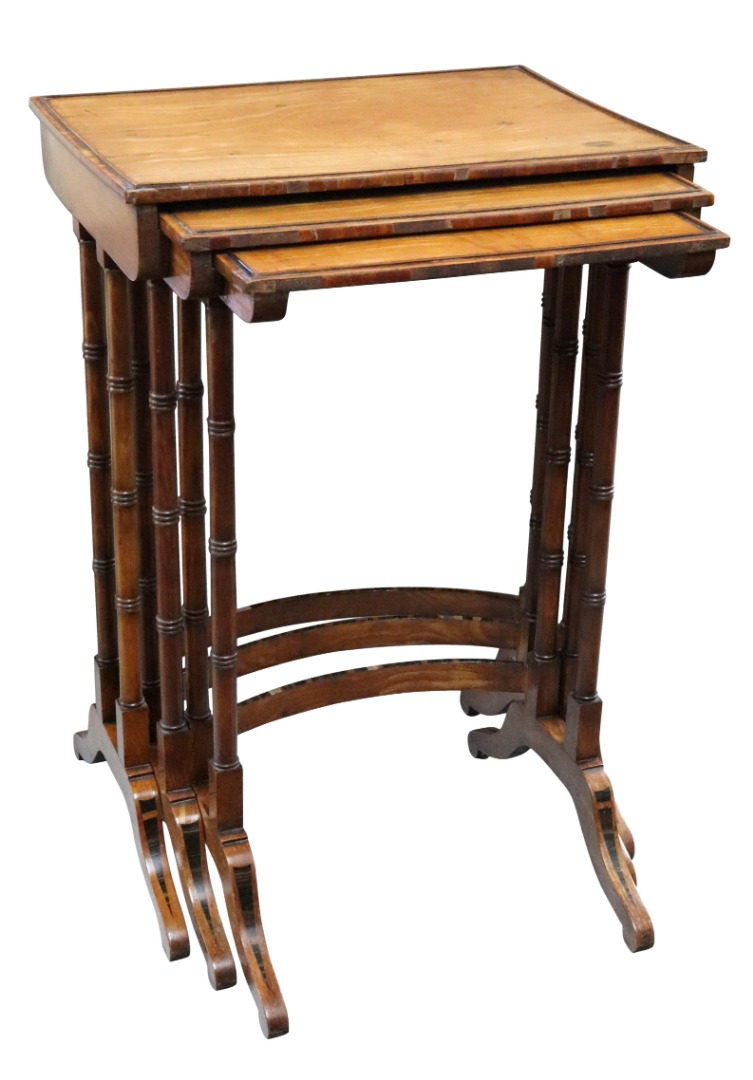 A nest of three Regency satinwood and... Image