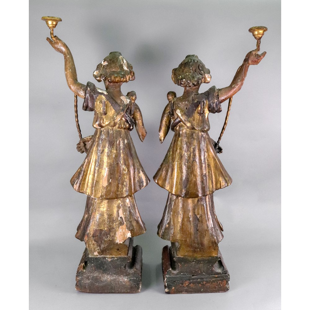 A pair of Italian carved pine polychrome painted gesso and parcel gilt candlesticks, 17th... Image