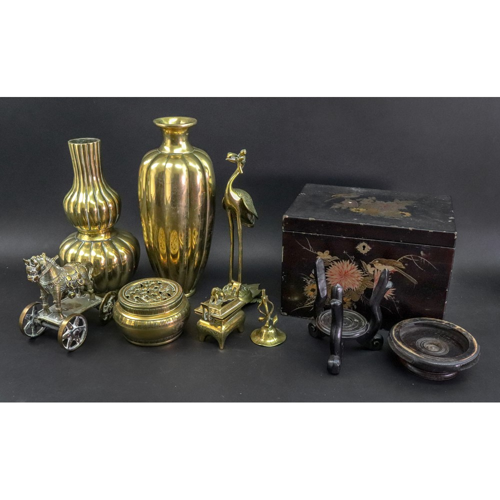 A group of Asian polished bronzed works of art, 19th/20th century, comprising; a tall Chinese... Image